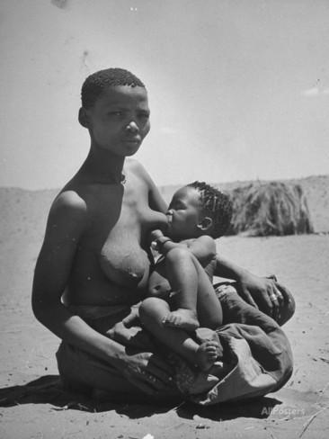 a-bushman-woman-breast-feeding-her-baby